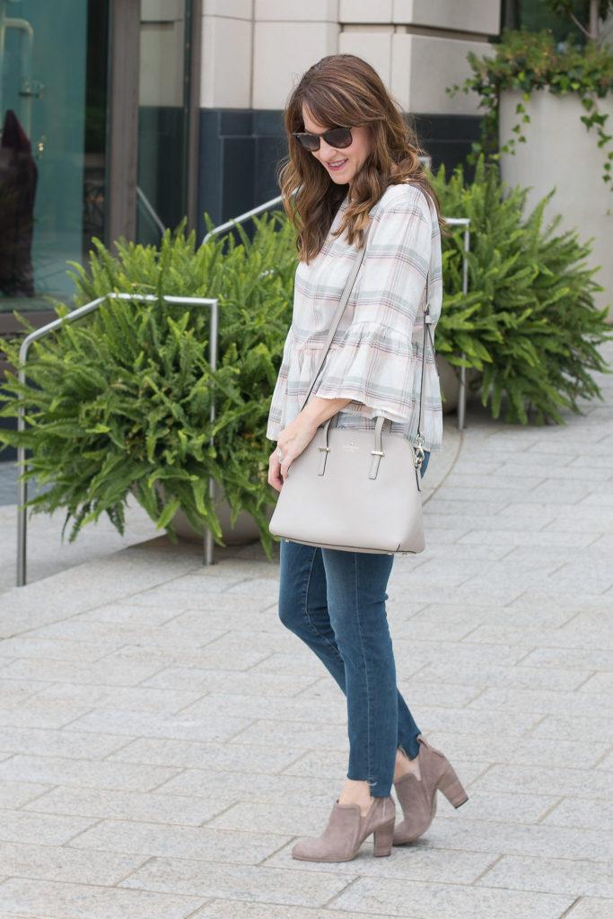 Gray crossbody bag outfit via Peaches In A Pod blog.
