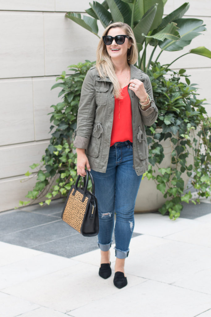 Cute fall outfit with a red cami and military jacket.