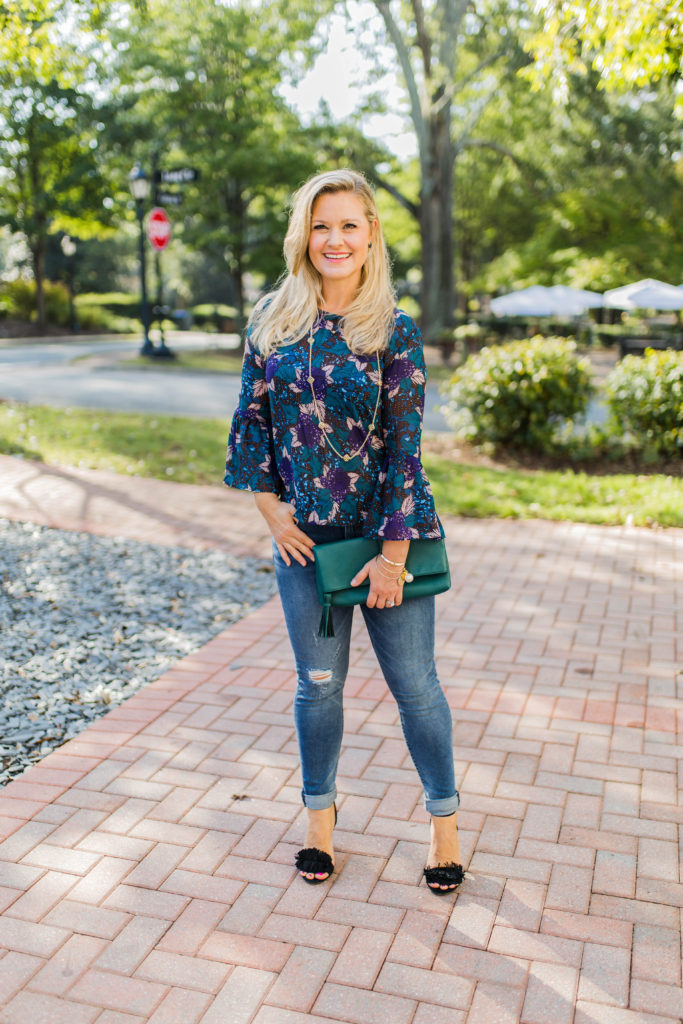 Cute floral print top with bell sleeves that is perfect for date night.