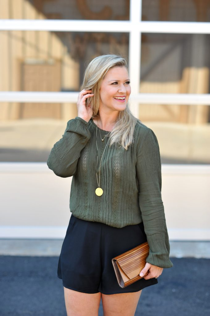 Olive green top that is perfect for fall and can be dressed up or worn casually.