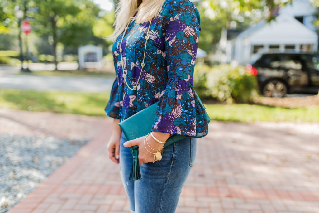 The perfect teal tassel fold over clutch that you can wear year round.