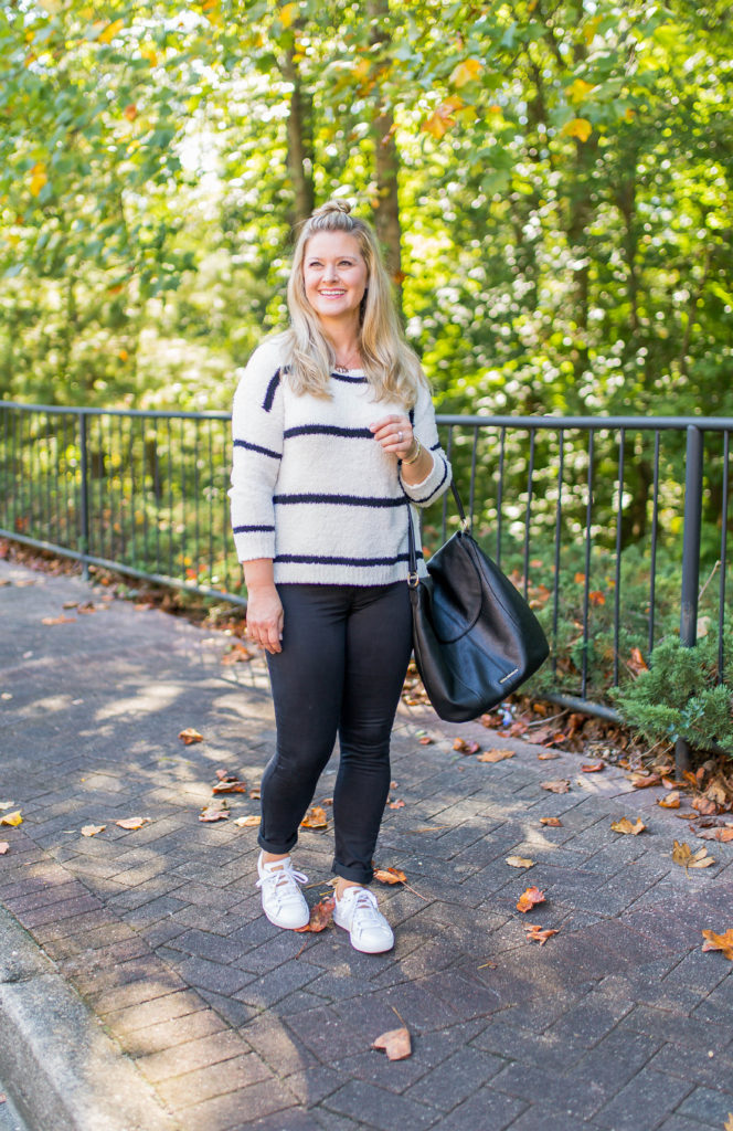 how to style black jeans in the fall with sneakers and an easy top knot!