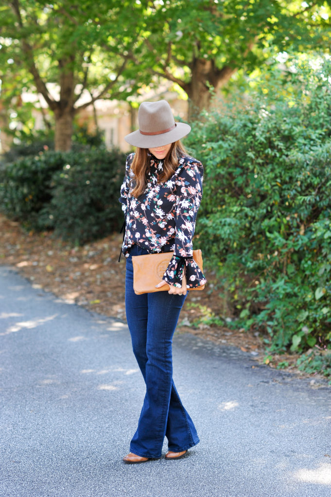 How to wear floral for fall via Peaches In A Pod blog. Fall fashion for women featuring a pretty floral print and flare jeans.