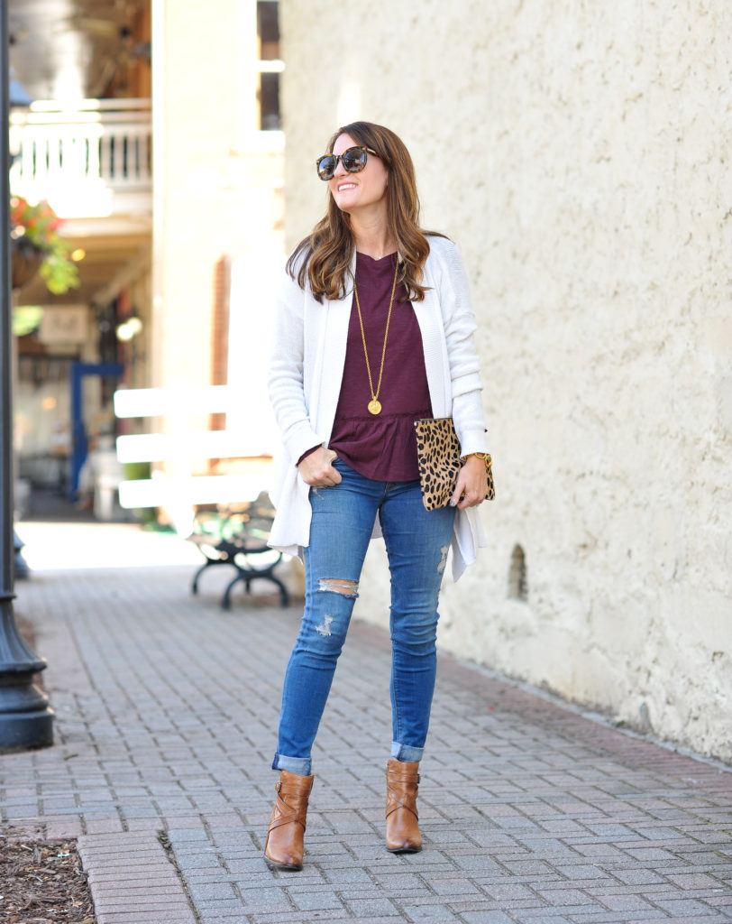 The perfect fall outfit idea via Peaches In A Pod blog. Burgundy peplum top, cardigan and leather ankle boots.