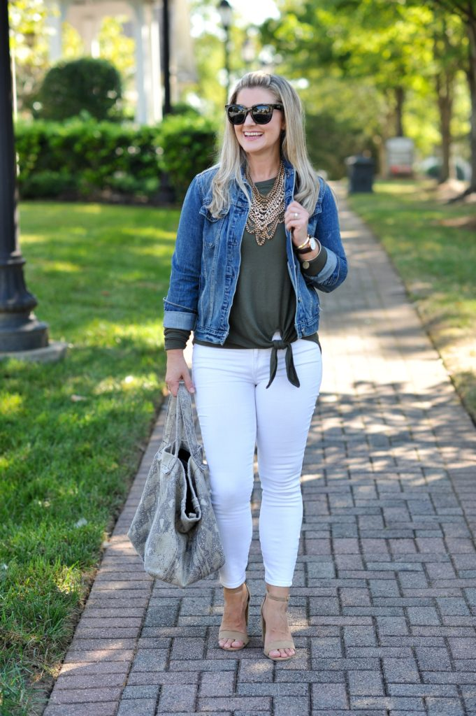 cute white jeans outfit that is perfect for fall. Paired with a front tie top and jean jacket.