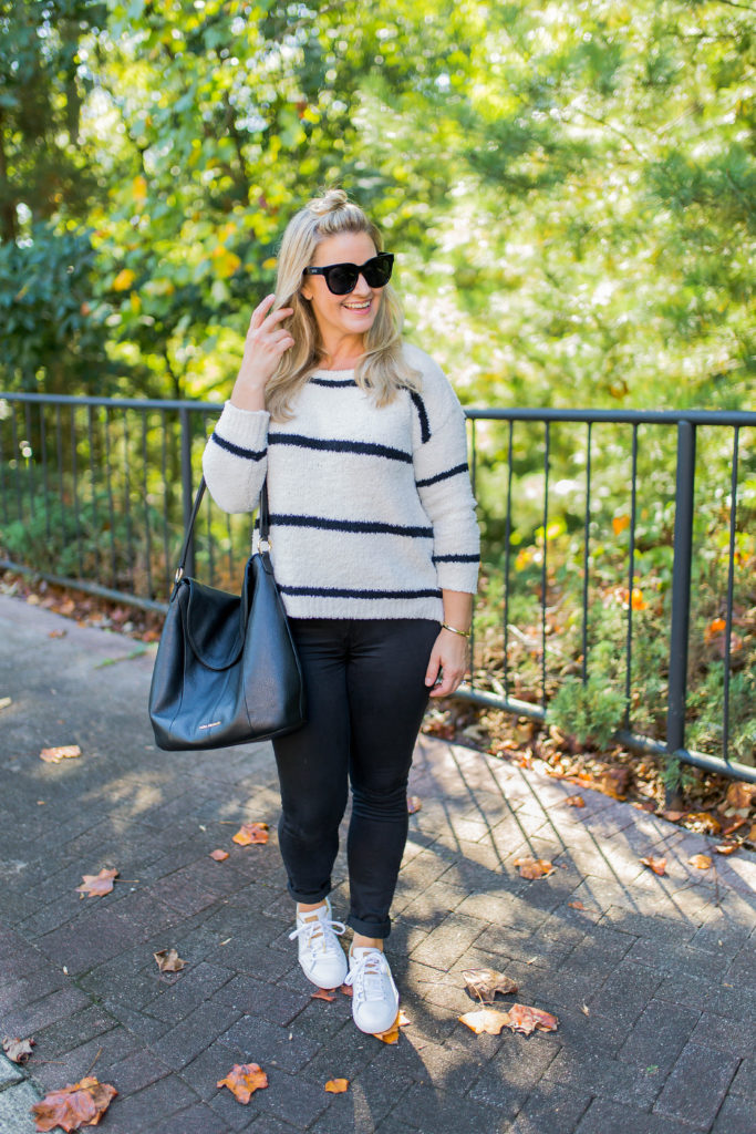 how to style sneakers with black jeans and a striped sweater to create a great casual outfit.
