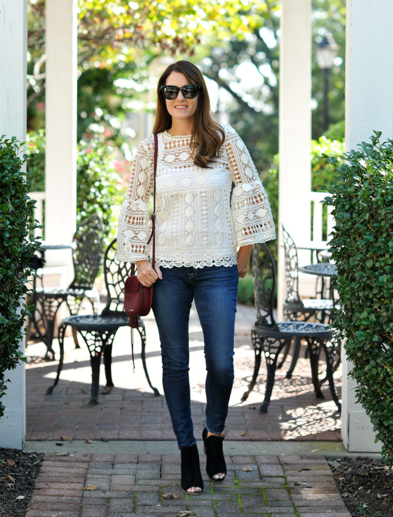 How to style a lace top for fall via Peaches In A Pod blog. We love this feminine top paired with these cute black peep toe boots by Lucky Brand.