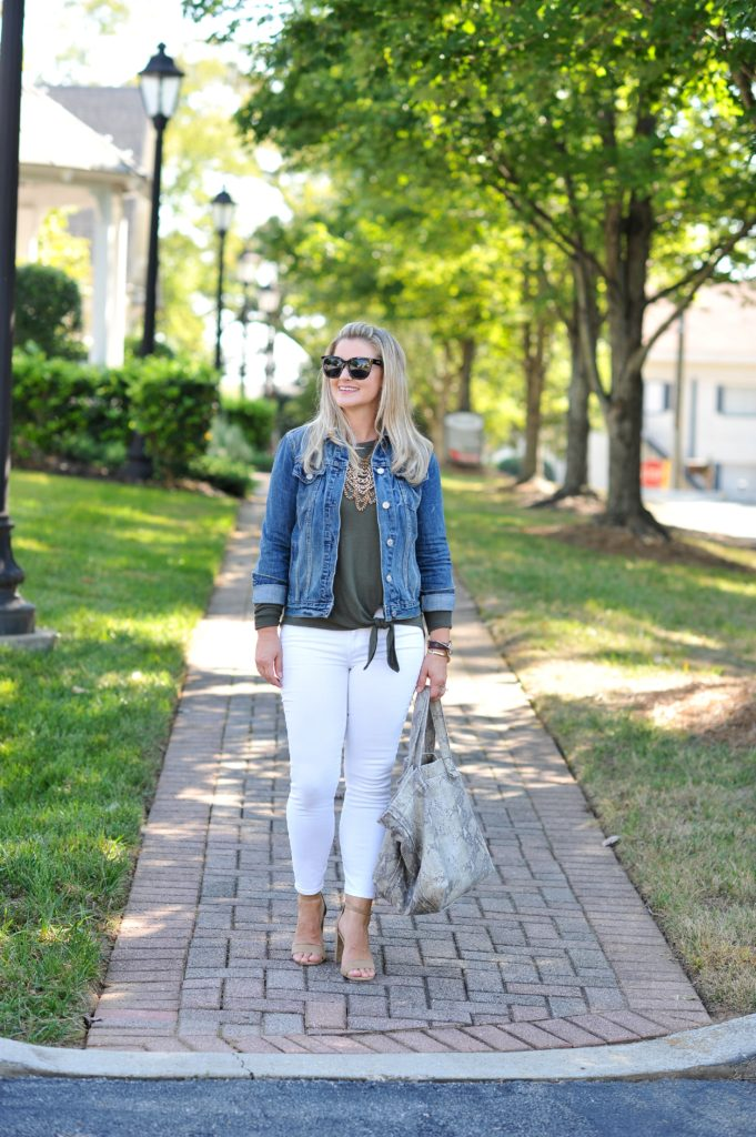 Cute fall outfit with white jeans and an olive top.