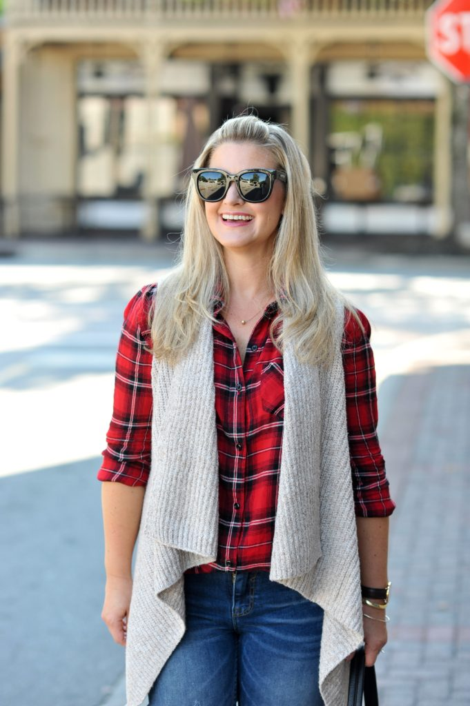 The perfect flannel shirt for Fall paired with a drapy vest and distressed jeans.