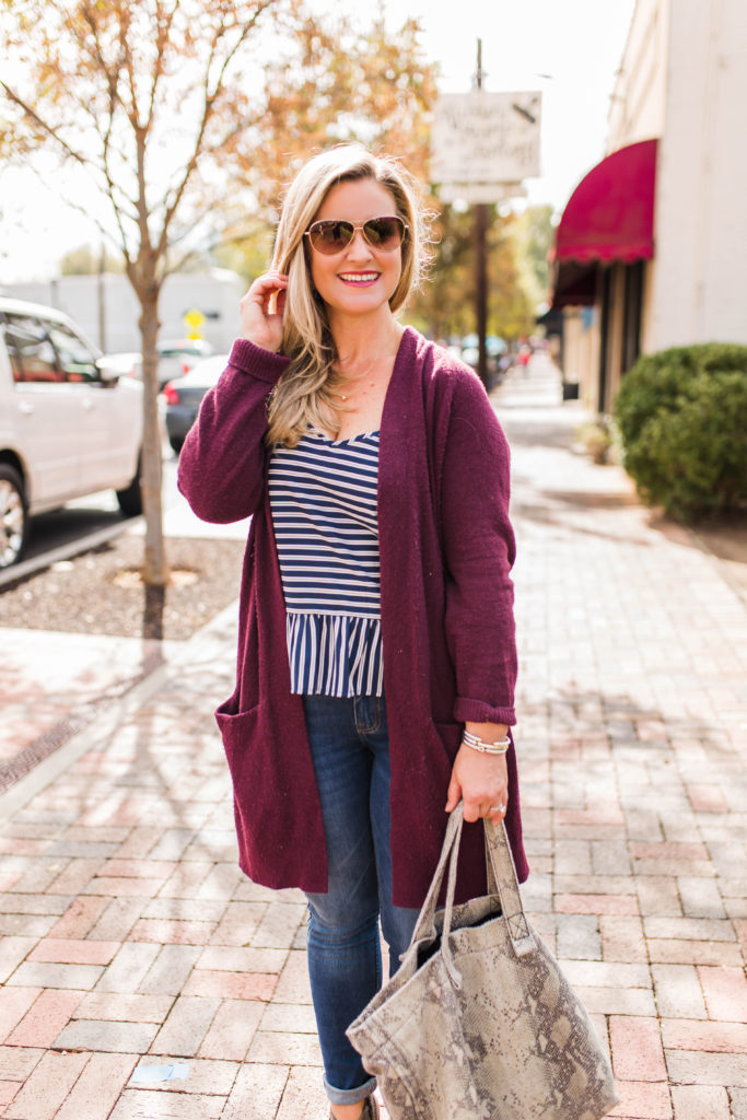 How to create an easy casual outfit with a cranberry sweater and a peplum top.
