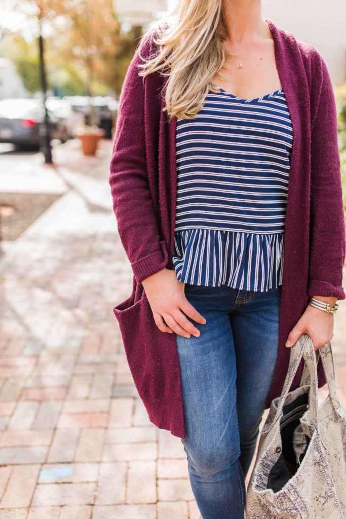 How to layer a peplum top with an oversized cardigan to create the perfect casual fall outfit.