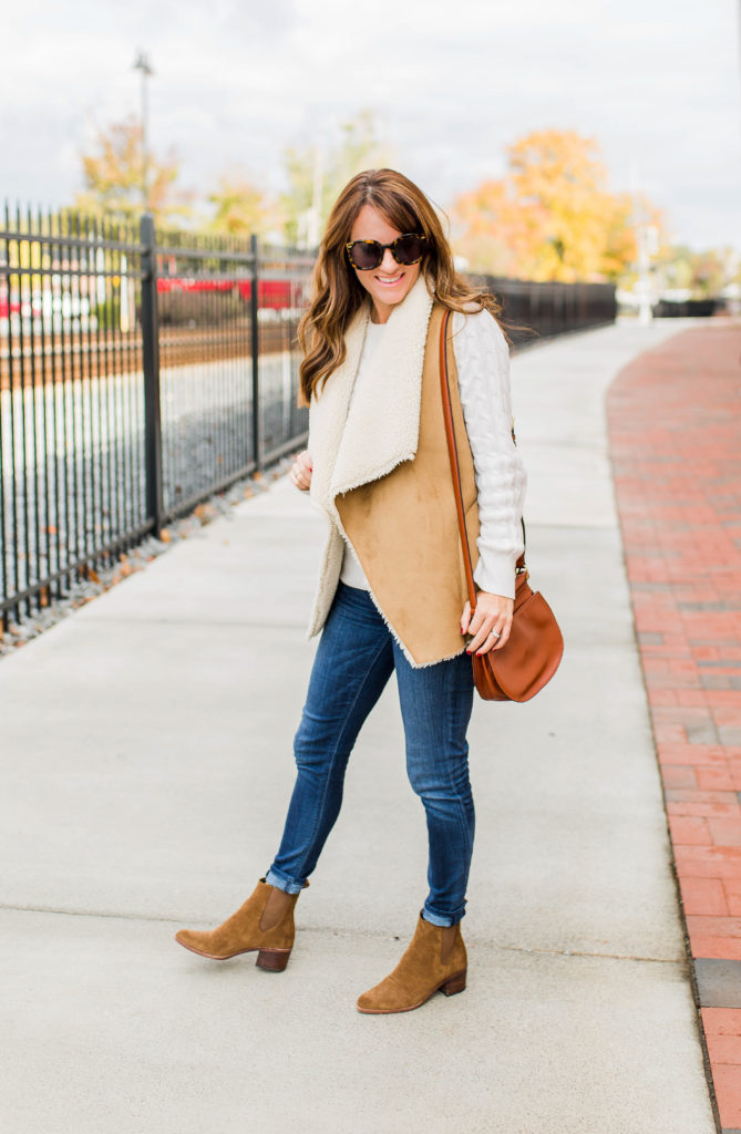 Casual winter style for women via Peaches In A Pod blog. Sherpa vest, and Dolce Vita Colbey boots.