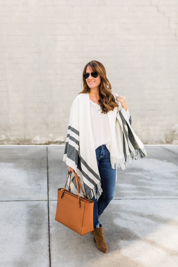 Cute poncho outfit for women via Peaches In A Pod blog.