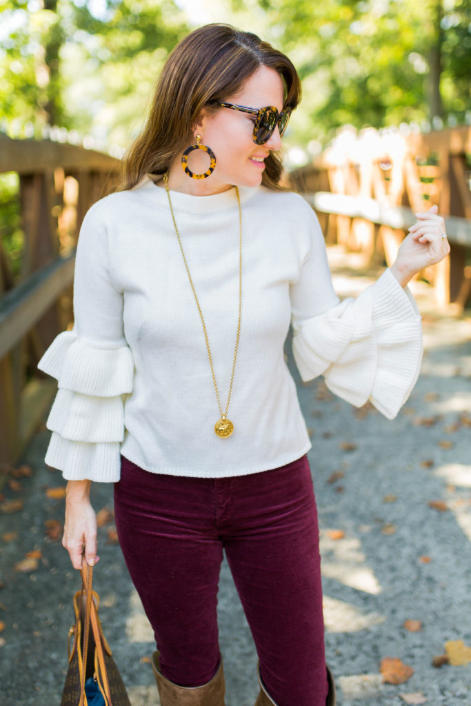 How to wear a ruffle sleeve sweater via Peaches In A Pod blog.