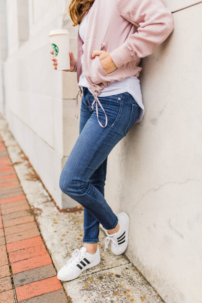 Women's casual outfit via Peaches In A Pod blog. Bomber jacket and Adidas sneakers outfit.