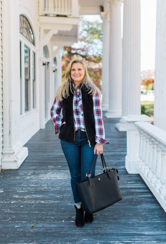 How to layer a black vest with a plaid top for the perfect holiday casual look