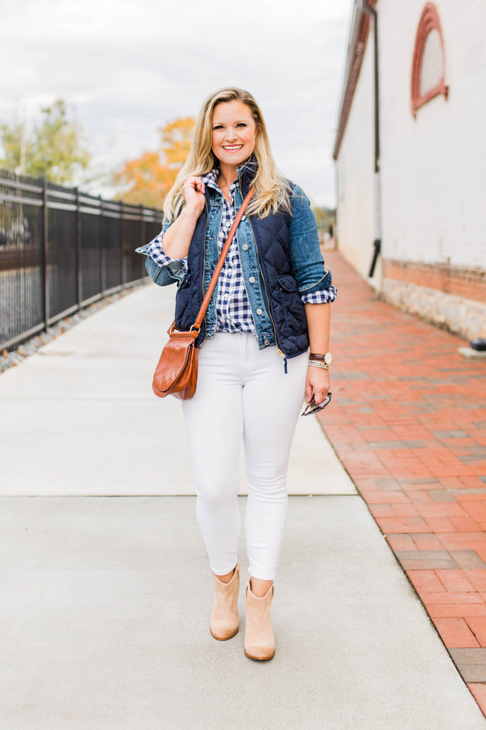 Cute casual white jeans outfit that is perfect for winter. Layering a jean jacket with a vest to create a great casual look that is warm.