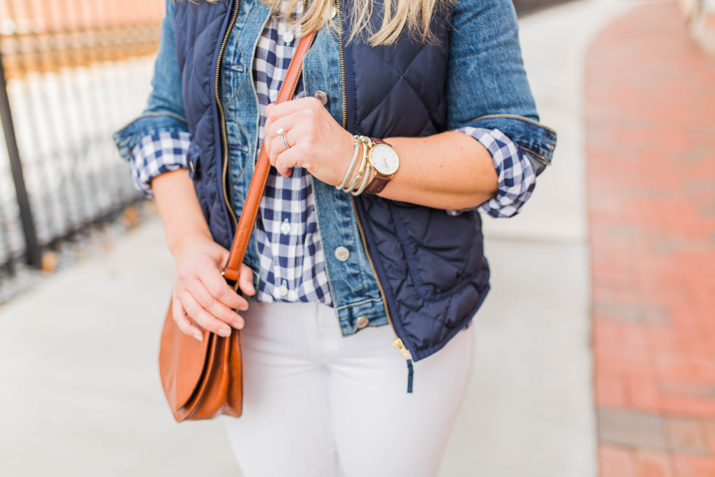 How to layer a jean jacket with a vest.