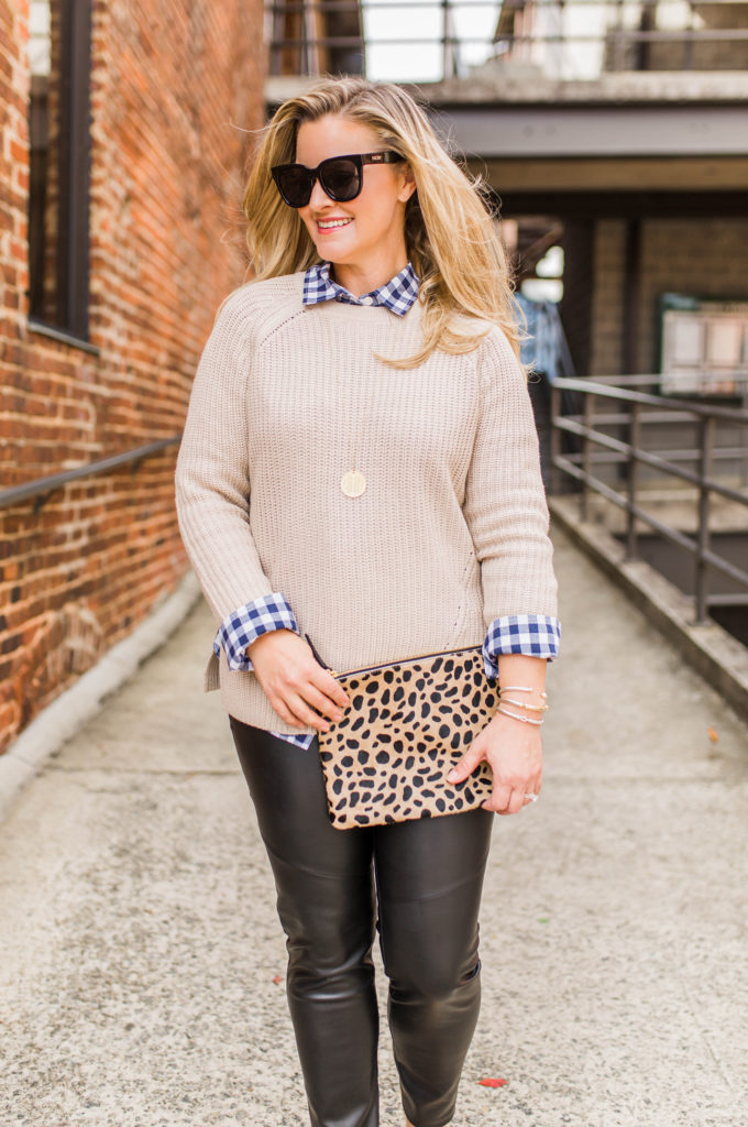 tan sweater layered with a gingham to create a great winter outfit.