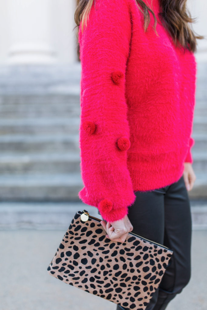 Cute pom sweater via Peaches In A Pod blog.