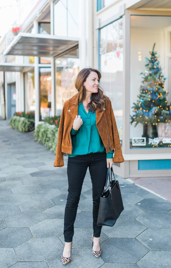 Dressy holiday outfit idea for women via Peaches In A Pod. Green satin blouse, suede moto jacket, leopard heels.