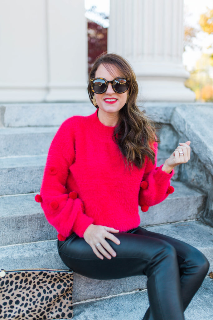 Women's Holiday style via Peaches In A Pod blog.  Red pom sweater and faux leather leggings.