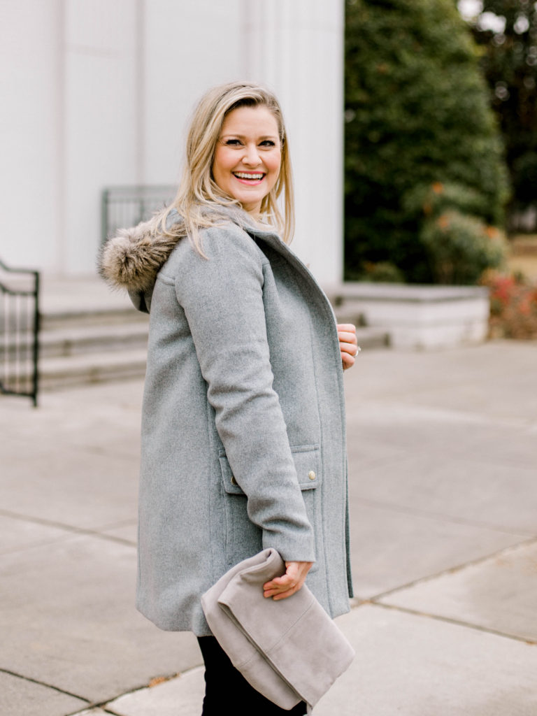 Fur trim hooded wool coat that is great for the wintertime.