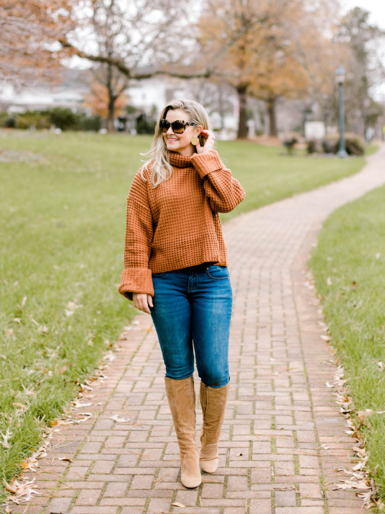 How to style a bell sleeve sweater with jeans to create a great winter outfit.