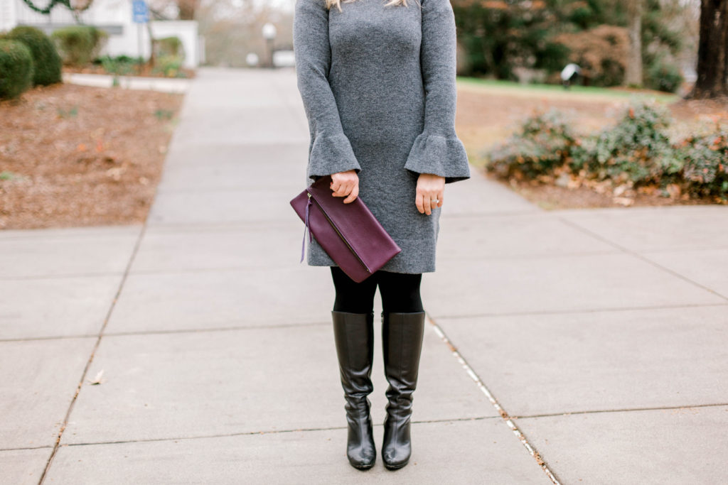 cute dress outfit styled with tights and tall boots.