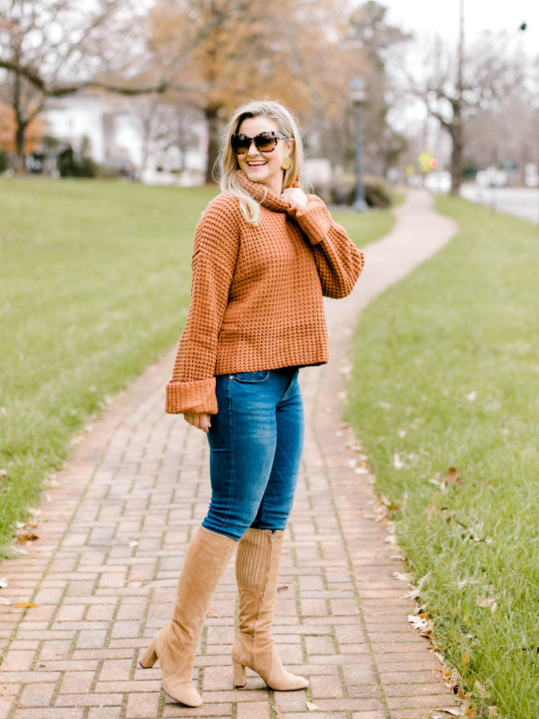 Cute winter outfit with a turtleneck sweater and tall boots.