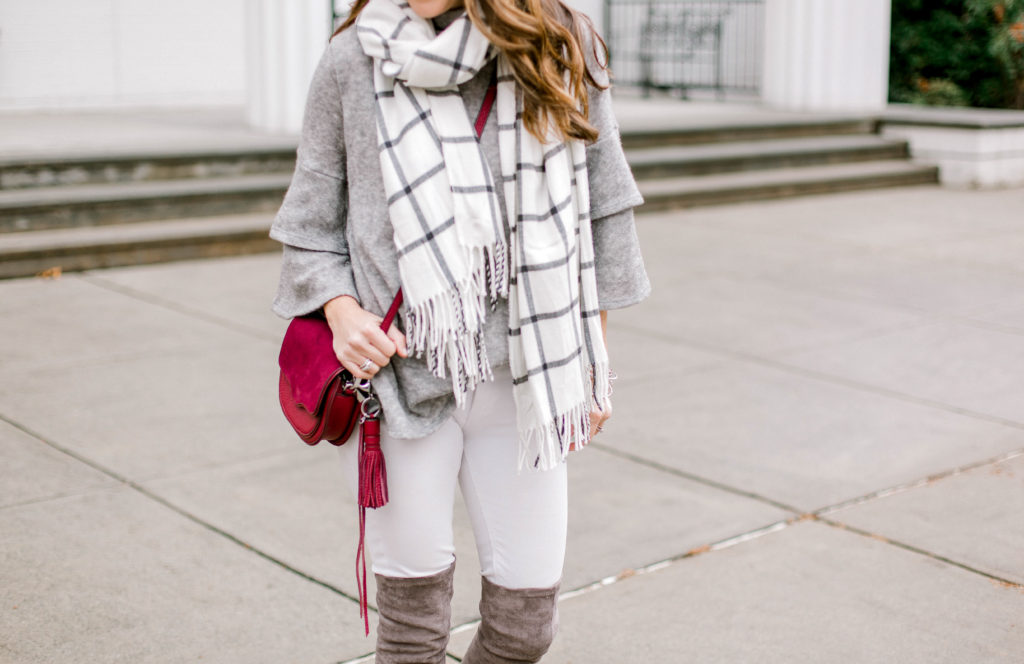 Cute winter outfit idea via Peaches In A Pod blog. Plaid scarf, white denim, gray over the knee boots.