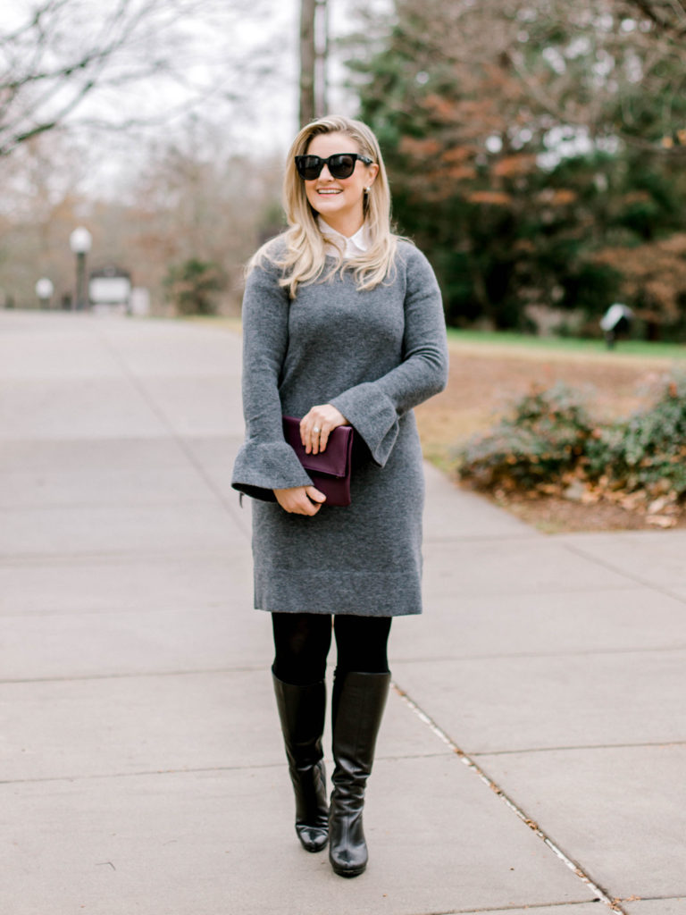 Cute winter outfit with a sweater dress and tights.