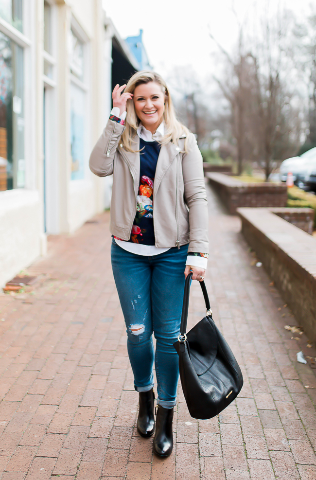 Great Spring transition outfit with a floral sweater and gray leather jacket