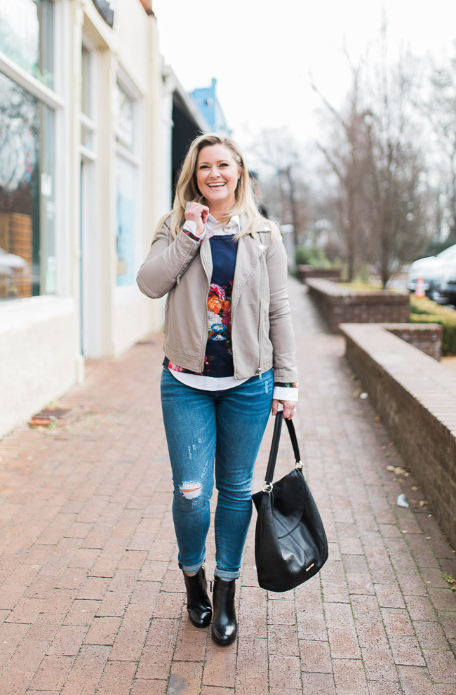 The perfect spring transition outfit with a floral sweater and gray leather jacket
