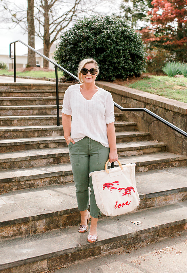 Casual Spring outfit with a cute white top, green pants and the perfect metallic sandals.